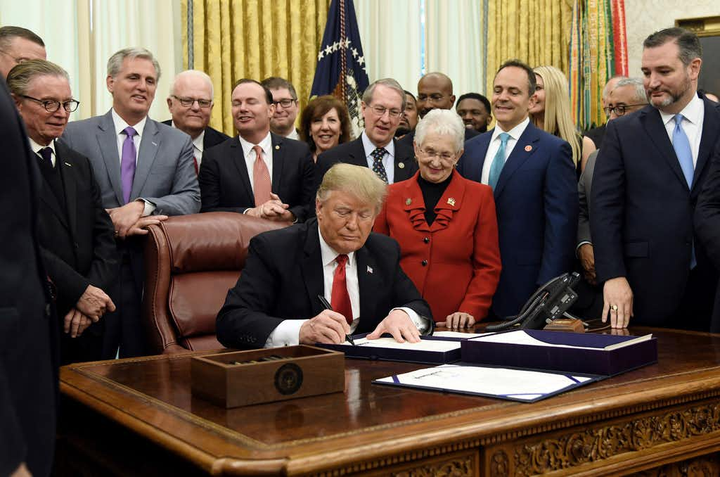 President Donald Trump signed criminal justice overhaul measures in the Oval Office on December 21, 2018. At right, in beard, is Sen. Ted Cruz.  Photo by Olivier Douliery/ Abaca Press(Olivier Douliery/TNS)