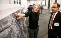 """<p><span style=""""font-size: 1em; background-color: transparent;"""">Pam Baker (left) asks questions of Spenta Irani, project manager for Jacobs, during a recent public meeting on transportation options within the Dallas Midtown project area.</span></p>(Nathan Hunsinger/Staff Photographer)"""