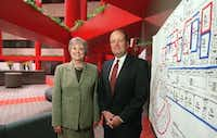 """<p><span style=""""font-size: 1em; background-color: transparent;"""">Parish Episcopal Head of School Gloria Snyder and Tom Carter, board chairman of the school, posed in 2002 with blueprints showing the conversion of the old Mobil Technology Center in Farmers Branch into the new school building.</span></p>(DMN file photo)"""