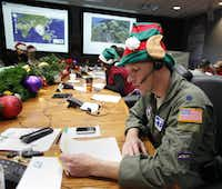 Air Force Lt. Col. David Hanson of Chicago takes a phone call from a child in Florida at the Santa Tracking Operations Center at Peterson Air Force Base near Colorado Springs, Colo.(2010 File Photo/The Associated Press)