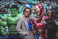 Mavericks CEO Cynt Marshall is flanked by the Incredible Hulk, Iron Man and the Black Widow at a Mavs game.(Steve Chavera/Dallas Mavericks)