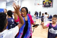 Dallas Mavericks CEO Cynt Marshall high-fived kids at the Mavs Spring Break Hoop Camp in March. (David Woo/Staff Photographer)