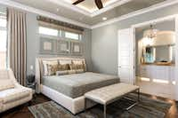 Dallas-based interior designer Barbara Gilbert wanted to provide a relaxing master suite where the homeowner of this room could  relax, read a book or watch TV,  she says. For instant sophisticated art, she framed metallic patterned prints matched to the room s neutral palette. (Michael Hunter/Michael Hunter)
