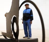 Melvin Edwards poses for a photograph near one of his sculptures, 'The Fourth Circle, 1966,' at the Nasher Sculpture Center in 2015. An exhibition at the time of Edwards' welded steel sculptures encompassed his work over the previous five decades.(Rose Baca/Staff photographer)