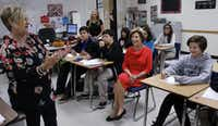 Former first lady Laura Bush attends an English Gifted and Talented class with 8th graders that are taking  the class for 9th grade credit on Oct. 21, 2014 at Wilkinson Middle School in Mesquite. Bush mingled with students and attended a roundtable with teachers and principals to announced a $7,000 grant from the Laura Bush Foundation For American Libraries.(David Woo/Staff Photographer)