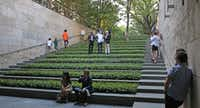 Art patrons listen to the sound work, created by artist Luke Fowler, exhibited at the Nasher Sculpture Center on May 10, 2018.(Louis DeLuca/Staff Photographer)