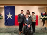 "Texas Gov. Greg Abbott met on Wednesday in Tokyo with Toyota Motor Corp. president and chief executive Akio Toyoda, left, to discuss the company's ""continued investment"" in Texas. Directly behind Abbott is first lady Cecilia Abbott. The woman at right was identified, without name, as Toyoda's wife.(Courtesy photo/Office of Texas Gov. Greg Abbott)"