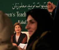 ORG XMIT: *S0412380556* U.S. first lady Laura Bush meets with teachers at the teacher training institute at Kabul University in Kabul, Afghanistan, Wednesday, March 30, 2005.(CHARLES DHARAPAK/AP)