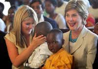 """<p><span style=""""font-size: 1em; background-color: transparent;"""">Laura Bush, with daughter Jenna and Rwandan children in Kigali, went on an official visit to Africa after a meeting of the G8 leaders in Gleneagles, Scotland in 2005.</span></p>(MIKE HUTCHINGS/REUTERS)"""