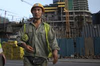 Chinese construction workers on site working at a new shopping mall called The Mall at One Galle Face, which is part of the Chinese-managed Shangri-La retail and office complex on Nov. 10, 2018 in Colombo, Sri Lanka. In just a few years Port City will be the site of tall glass skyscrapers, a busy financial district, hospitals, hotels and even a theme park. For China, the relationship with Sri Lanka ties back thousands of years when it was a stop along the old Silk Road trade routes, as it is now known to be a critical link for its Belt and Road Initiative, which aims to expand trade across 65 countries from the South Pacific through Asia to Africa and Europe.  (Paula Bronstein/Getty Images)