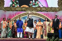 Indian Prime Minister Narendra Modi (C) waves on stage during the Bhartiya Janta Party (BJP) Mahila Morcha Sammelan (women convention) in Adalaj, some 30 kms from Ahmedabad on Dec. 22, 2018. (Sam Panthaky/Agence France-Presse)