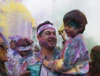 How will you color your world this year? At the color Run in Fair Park a few years ago, Hector Ochoa holds his nephew Leo Cruz. in this file photo.(Eve Edelheit/The Dallas Morning News)