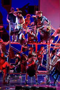 Actors stack rolling scaffolding in Junior Players' production of Green Day's <i>American Idiot</i>, directed by Valerie Hauss-Smith, at Moody Performance Hall.(Ben Torres/Special Contributor)