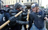 Anti globalization protesters clash with police in riot gear Nov. 20, 2003 on the fourth day of the summit to create a Free Trade Area of the Americas being held in Miami, Fla. Hundreds of protesters, including groups of anarchists, clashed with the police throughout the morning as the protesters unsuccessfully tried to make their way to the summit building.(Spencer Platt/Getty Images)