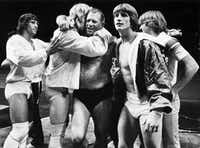 Fritz (center), patriarch of the Von Erich family of wrestling, including sons (from left) Kerry, David, Kevin and Michael. A fifth son, Chris Von Erich, is not pictured.(File Photo/Staff)