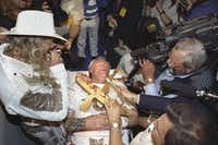 """<p>Southwest Airlines' Chairman Herb Kelleher made a melodramatic exit on a gurney after losing&nbsp;to Stevens Aviation Chairman Kurt Herwald in&nbsp;the ironically titled """"Malice in Dallas"""" arm-wrestling match in March 1992 at the Sportatorium.</p>(1992 File Photo/Staff)"""
