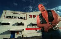 Steve Williams, better known as professional wrestler Stone Cold Steve Austin, posed outside the Sportatorium for a 1998 High Profile feature in <i>The Dallas Morning News</i>. Williams, who played football at the University of North Texas, got his start in pro wrestling at the Dallas arena.(1998 File Photo/Staff)