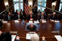 "President Donald Trump speaks Wednesdayduring a cabinet meeting at the White House.. From left are Secretary of Health and Human Services Alex Azar, acting Secretary of the Interior David Bernhardt, Trump, acting Secretary of Defense Patrick Shanahan, and Secretary of Commerce Wilbur Ross. On the table: a movie-style poster of Trump that says ""Sanctions are Coming.""(Evan Vucci/The Associated Press)"