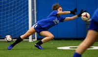 Lilly Heit blocks a shot during soccer practice at Frisco High School.(Vernon Bryant/Staff Photographer)