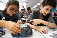 Maria Martinez, 14, (left) and Neryce MacWilliam, 12, put together a VEX robot as students from Westpoint assist DISD stem camp at Henry W. Longfellow Career Exploration Academy in Dallas June 7 ,2017.(2017 File Photo/Staff)