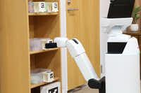 A Toyota human support robot can do simple tasks like tidying up or delivering meals.(Toyota)
