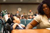 Alongside her medically fragile 3 yr-old son D'ashon Morris, Linda Badawo of Mesquite, Texas testifies before members of the Texas House Committee on Human Services, Wednesday, June 20, 2018 after a recent Dallas Morning News story regarding Medicaid managed care and the Health and Human Services Commission. (Tom Fox/Staff Photographer)