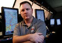Nick Daniels, a local leader for the National Air Traffic Controllers Association, has no choice but to come to work, ensuring that aircraft make their destinations safely during the government shutdown. Daniels is pictured in the simulation room of their Fort Worth offices.(Tom Fox/Staff Photographer)