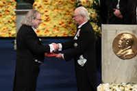 Immunologist James Allison, left, received his Nobel Prize from King Carl XVI Gustaf of Sweden during an award ceremony in December in Stockholm, Sweden.(JONATHAN NACKSTRAND/AFP/Getty Images)