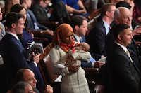 Newly elected congresswoman Ilhan Omar (D-MN)holds a baby during the 116th Congress and swearing-in ceremony on the floor of the US House of Representatives at the US Capitol on January 3, 2019 in Washington,DC.(Saul Loeb/Agence France-Presse)