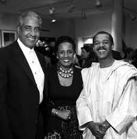Mohamed Toure (right) attended the grand opening of his wife's store, Out of Africa, in December 1994.(Staff/File Photo)