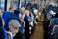 Travelers waited in their seats for a preview trip on Trinity Metro's TEXRail  to DFW Airport from the Grapevine/Main Street Station in Grapevine on New Year's Eve.(Nathan Hunsinger/Staff Photographer)