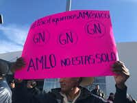 Raymundo Ramirez supportsl Lopez Obrador's plan to create a national guard to make Mexico safe again. Demonstrating Saturday in Ciudad Juarez, he said the new  national guard was needed because local and state police are dangerous and corrupt.(Alfredo Corchado/Staff )