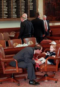 Dennis Bonnen, as a 24-year-old  freshmen state representative, played with his niece, Lindsay Bonnen, 2, after being sworn into office in 1997. His family did not arrive to see him  sworn in, but instead came at the close of the opening day session. They were  delayed by the icy road conditions.(File Photo/Staff)