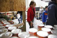 Volunteer April Leonard assembles meals for qualifying children at Frisco Fastpacs headquarters.(Rose Baca/Staff Photographer)