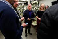 Former New York City Mayor Michael Bloomberg (center) talks with students in the Wind Technology program at Des Moines Area Community College, on Dec. 4, 2018, in Ankeny, Iowa. (Charlie Neibergall/The Associated Press)