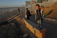 Hector Sanchez, 6, at play along the U.S.-Mexico border wall in the Las Playas area on Jan. 6, 2019 in Tijuana, Mexico.  The U.S.  government is going into the third week of a partial shutdown with Republicans and Democrats at odds on agreeing with President Donald Trump's demands for more money to build a wall along the U.S.-Mexico border.(Sandy Huffaker/Getty Images)