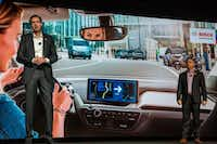 Bosch executives Markus Heyn (left) and Mike Mansuetti speak at the Bosch press conference at the Mandalay Bay Convention Center during CES 2019 in Las Vegas on January 7, 2019.(DAVID MCNEW/AFP/Getty Images)