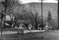 "Real estate ""for-sale"" signs are shown in the Little Mexico neighborhood of Dallas in 1981.  The World Trade Center can be seen in the background.(File Photo/Staff)"