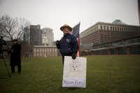 "David Fitzpatrick, 64, a park ranger, holds an American flag and a placard stating ""You're fired"" with Smokey the Bear, after a protest rally with furloughed federal workers and area elected officials in front of Independence Hall on Jan. 8, 2019 in Philadelphia, Pa. (Mark Makela/Getty Images)"