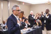 Dr. Shahid Shafi speaks before members of the State Republican Executive Committee following a vote Dec. 1 in favor of resolution that opposes an effort by the Tarrant County Republican Party to remove him as vice chair because of his religion. Email exchanges involving county Republican leaders in Texas reveal efforts to remove Shafi, a party vice chairman because he's Muslim.(Amanda Voisard/The Associated Press)