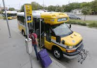 Maurice Chai, 26, from New Zealand takes the DART shuttle bus from the Inwood/Love Field DART station to Dallas Love Field on Oct. 8, 2014.(File Photo/Staff )