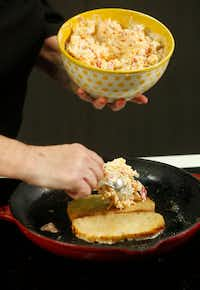 Pimiento cheese is put on grilling bread for grilled cheese sandwiches(Nathan Hunsinger/Staff Photographer)