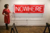 Alicia Eggert illuminates her neon sculpture <i>NOW/HERE</i>&nbsp;at the Mac in Dallas' Cedars neighborhood&nbsp;(Ryan Michalesko/Staff Photographer)