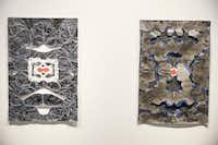 Constructed paper works <i>Serpentine (</i>left) and <i>Blue Flame</i> by artist Leslie Martinez (Ryan Michalesko/Staff Photographer)