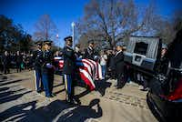 Honor guard members transport the remains of Richard Overton to his burial site the Texas State Cemetery on Saturday,(Ashley Landis/Staff Photographer)