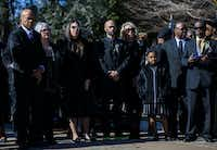 Family members wait as the remains of Richard Overton are transported to his grave site during a graveside service.(Ashley Landis/Staff Photographer)