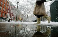 You'll have to conquer any fears of winter weather when you venture out in the East Village neighborhood of Manhattan. Be sure to bring a warm coat, plenty of layers and waterproof boots.(2003 File Photo/Getty Images)