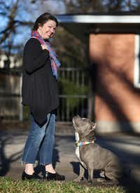 Deborah Rodriguez with her foster dog Hippo, who was rescued in July from a shelter in St. Landry's Parish in Louisiana. (Rose Baca/Staff Photographer)