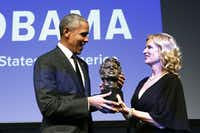 President Barack Obama receives the Robert F. Kennedy Human Rights' Ripple of Hope Award from the group's president, Kerry Kennedy,  at a ceremony on Dec. 12, 2018, in New York. (Jason DeCrow/The Associated Press)