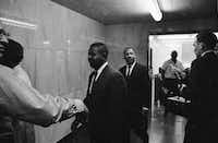 In this May 8, 1963 file photo, the Revs. Ralph Abernathy (left) and Martin Luther King Jr. walk through a corridor of the city jail in Birmingham, Ala., where they were held for several hours following conviction on charges of parading without a permit. They posted bond of $2,500.(The Associated Press)